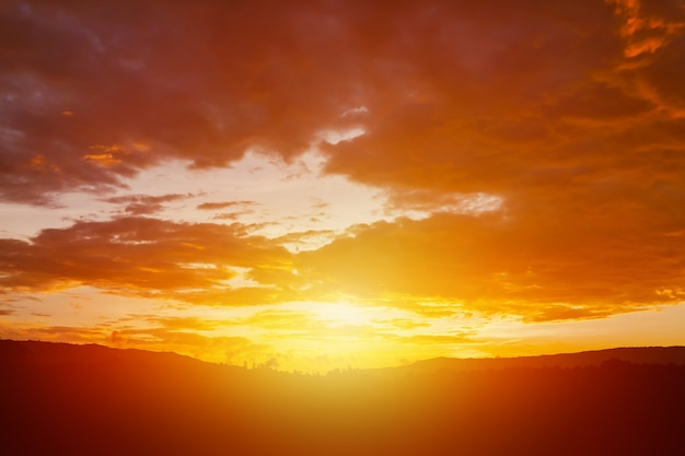 Bright orange sky clouds before rain at sunset. cloud on sunset for background Premium Photo