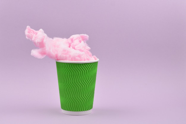 Bright pink candy cotton in plastic cup Premium Photo