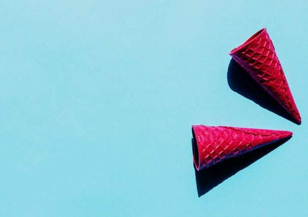 Bright pink empty waffle cones Free Photo