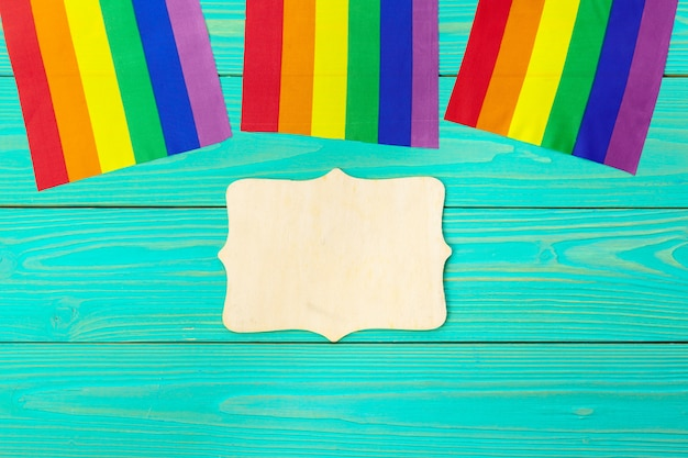 Bright rainbow gay flag on wooden background and blank space Premium Photo
