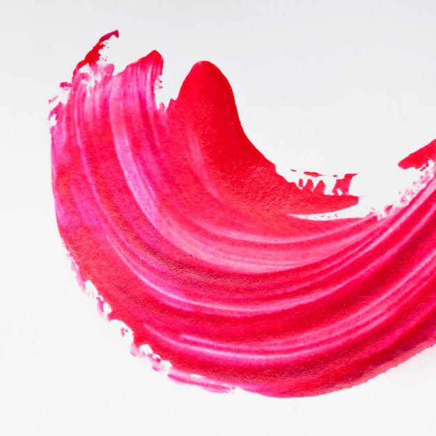 Bright red brush stroke on white background Premium Photo