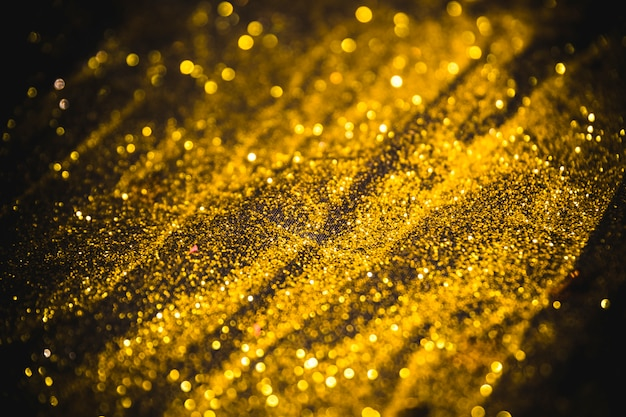Bright sequins scattered on table Free Photo