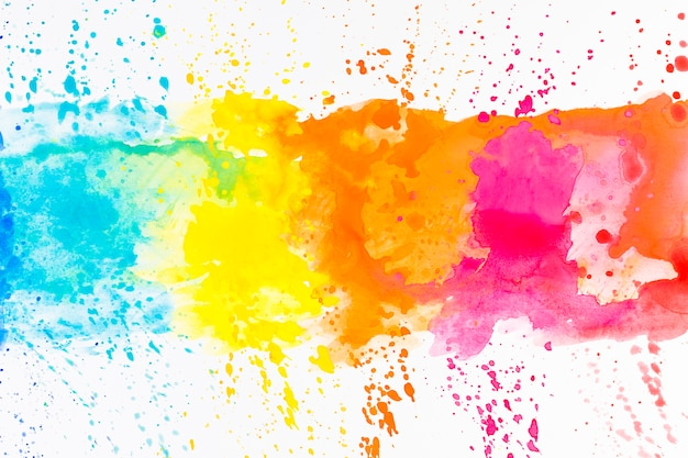 Bright splashes of dye on white Free Photo