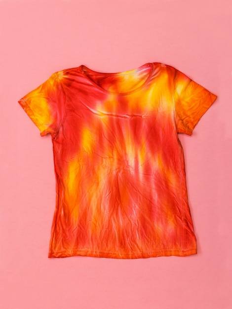 Bright t-shirt in tie dye style on pink Premium Photo