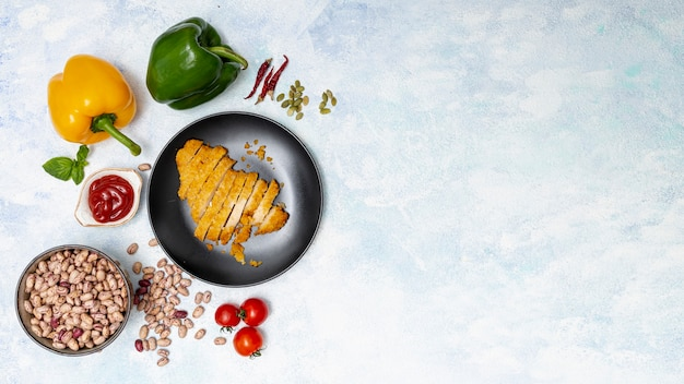 Bright vegetables and cut chicken on plate Free Photo
