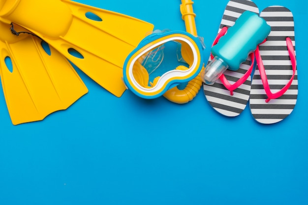 Bright yellow flippers and diving mask on a vibrant backround Premium Photo