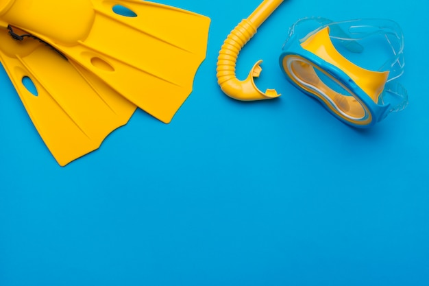 Bright yellow flippers and diving mask Premium Photo