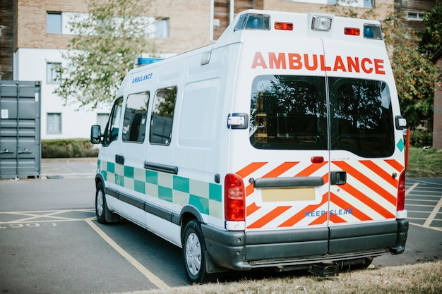 British ambulance parked in a parking lot Free Photo