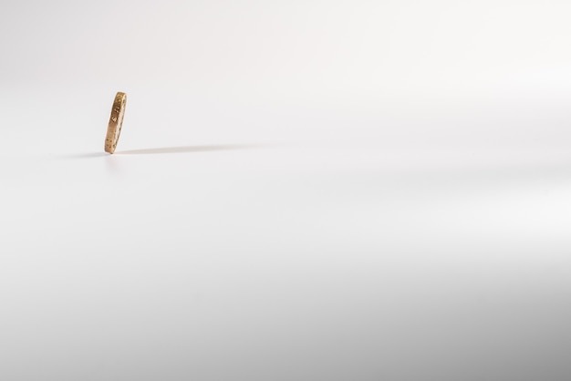 British pound coin falling on white background, isolated Premium Photo