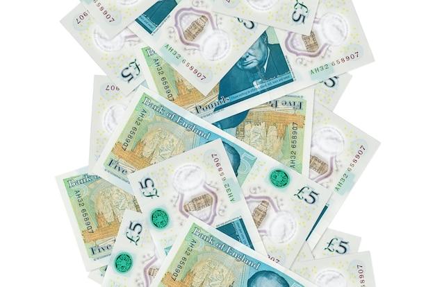Британские фунты стерлингов, летящие вниз изолированные с Premium Фотографии