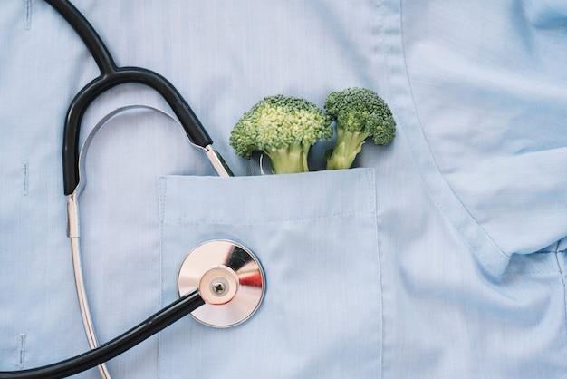 Broccoli inside a doctor's pocket Free Photo