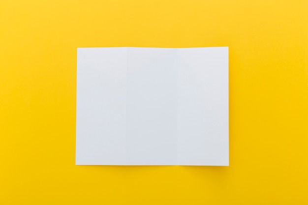 Brochure on yellow background Free Photo