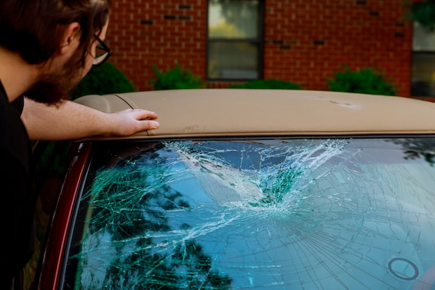 Broken car glass shuttered cracked for accident Premium Photo