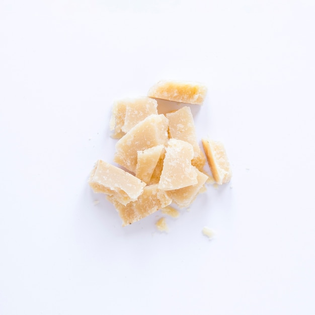 Broken cheese isolated on white background Free Photo