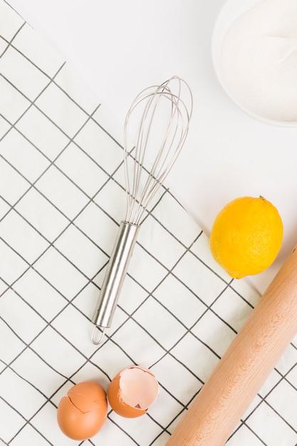 Broken eggshells; lemon; sugar and napkin isolated on white background Free Photo