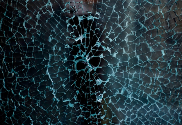Broken glass of a shop window of a clothing store with unfocused background Premium Photo