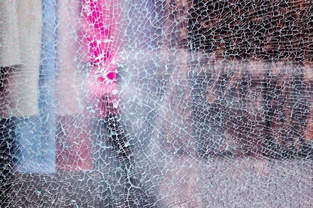 broken-glass-shop-window-clothing-store-with-unfocused-background_72928-291.jpg (626×416)