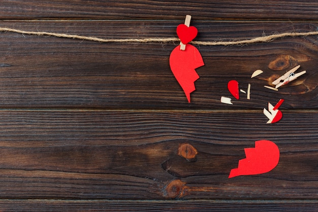 Broken heart breakup collection and divorce icon. red paper shaped as a torn love , health care problems due to illness. broken love concept Premium Photo