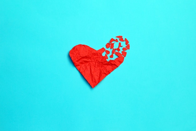 Broken heart breakup concept separation and divorce icon. red crumpled paper shaped as a torn love Premium Photo