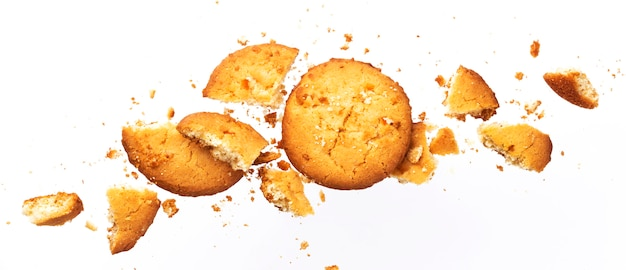 Broken oatmeal cookies isolated on white background Premium Photo