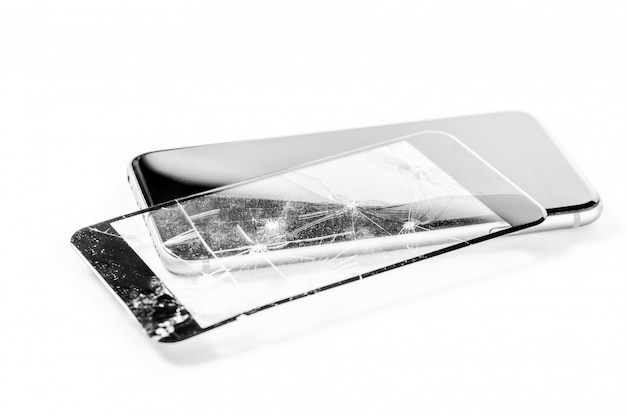 Broken phone isolated on white background Premium Photo