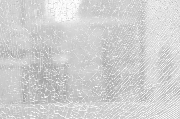 Разбитое безопасное стекло, треснувшее стекло. Premium Фотографии