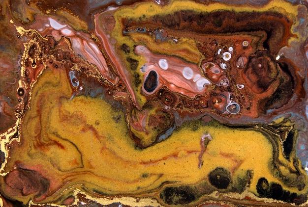 ブロンズとゴールドの霜降りパターン。黄金の大理石の液体テクスチャ。 Premium写真