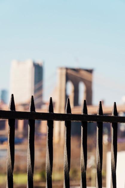 Brooklyn bridge through black fence Free Photo