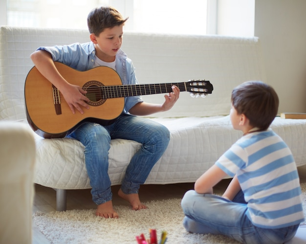 Brothers playing guitar Free Photo