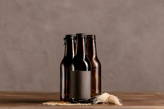 Brown alcoholic bottles in gray label on wooden table Free Photo
