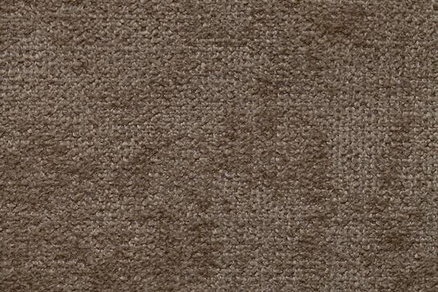 Brown background of soft, fleecy cloth, texture of textile closeup Premium Photo