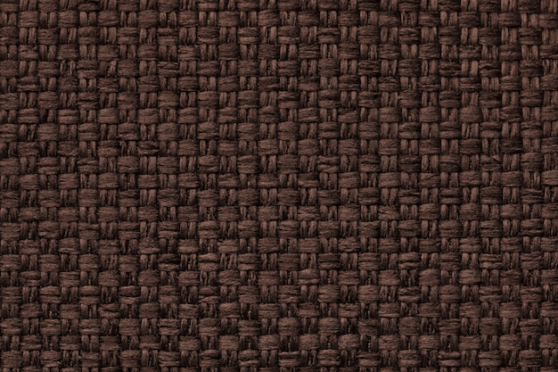 Brown background with checkered pattern, closeup. structure of the fabric macro. Premium Photo