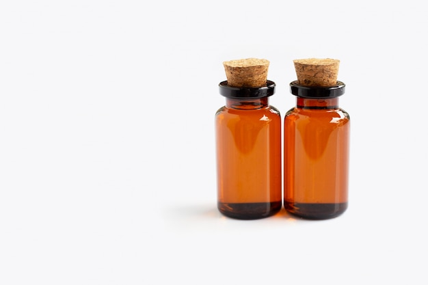 Brown bottle with essential oils on white Premium Photo