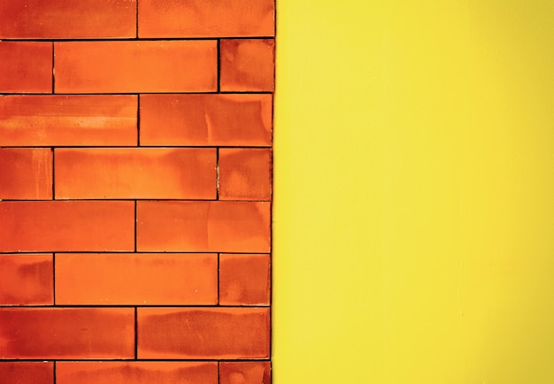 Brown brick wall light middle and yellow blocks for background Premium Photo