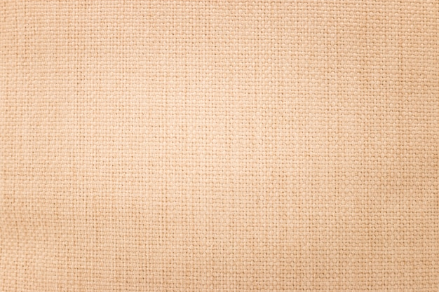 Brown burlap texture background. weave textile material or blank cloth. Premium Photo