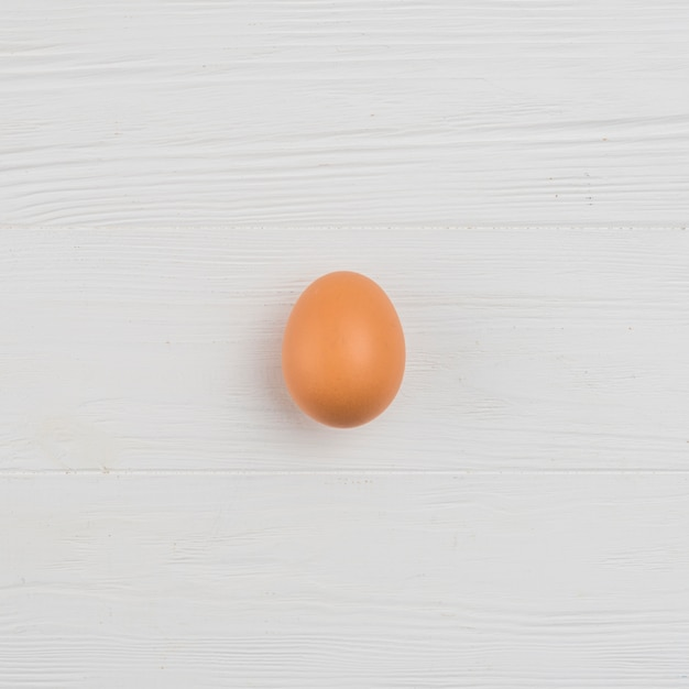 Brown chicken egg on table Free Photo
