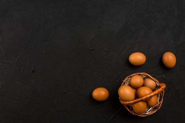 Brown chicken eggs in basket Free Photo