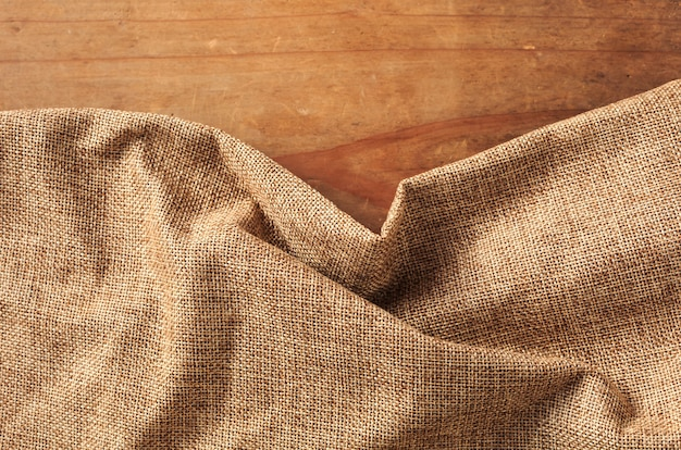 Brown cloth on wooden background Premium Photo