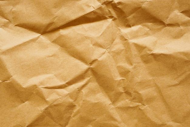 茶色のしわくちゃの紙リサイクルクラフトシートテクスチャ背景 Premium写真