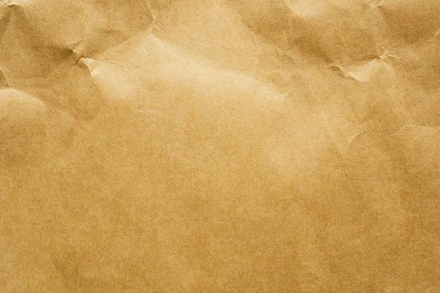 茶色のしわくちゃの紙リサイクルクラフトシートテクスチャ壁 Premium写真