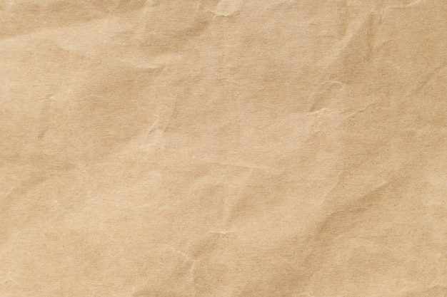 Brown crumpled paper texture for background. Premium Photo