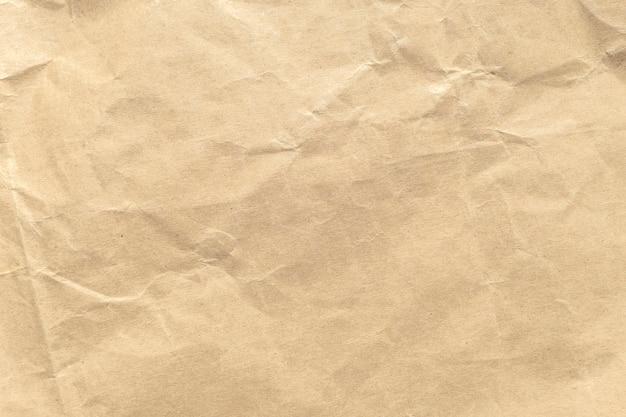 Brown crumpled paper texture background. Premium Photo