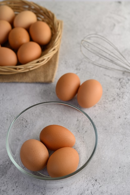 Brown eggs and glass bowl Free Photo