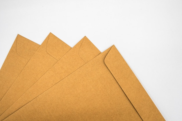 A brown envelope on a wooden floor surface Premium Photo