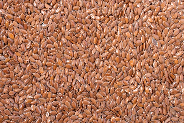 Brown flax seeds, background texture. organic superfood, top view Premium Photo