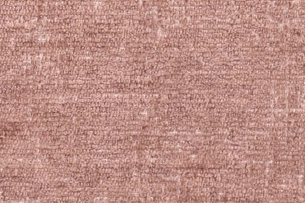 Brown fluffy background of soft, fleecy cloth, texture of textile closeup Premium Photo