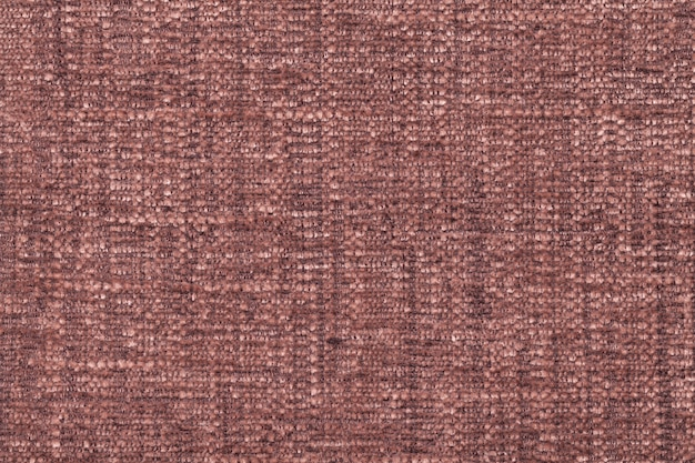 Brown fluffy background of soft, fleecy cloth. texture of textile closeup Premium Photo