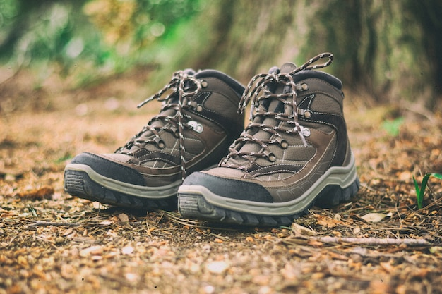 Brown hiking boots in a forest Premium Photo