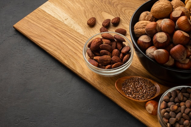 Brown huzelnuts on a wooden cutboard Free Photo