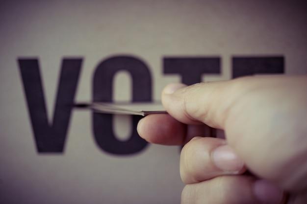 Brown paper insert in vote box, democracy concept, retro tone Premium Photo